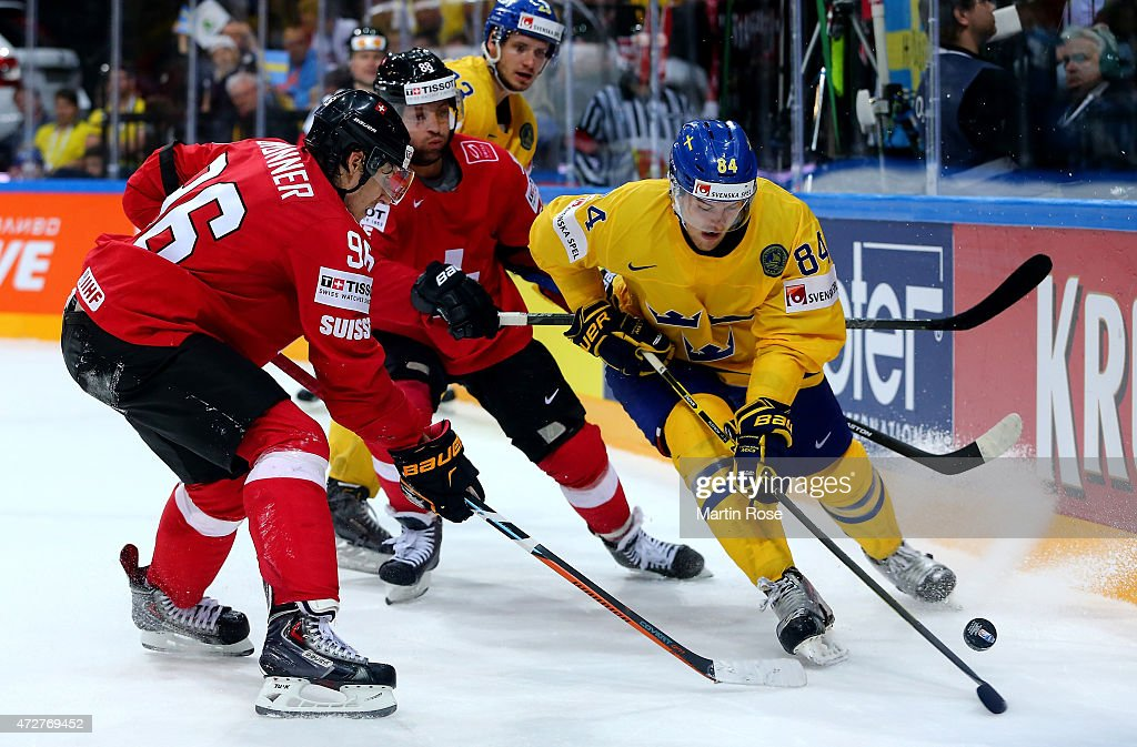 Oscar Klefbom (R) of Sweden and Damien Brunner (L) of Switzerland battle for the puck during the IIHF World Championship group A match between Austria and Switzerland at o2 Arena on May 9, 2015 in Prague, Czech Republic.
