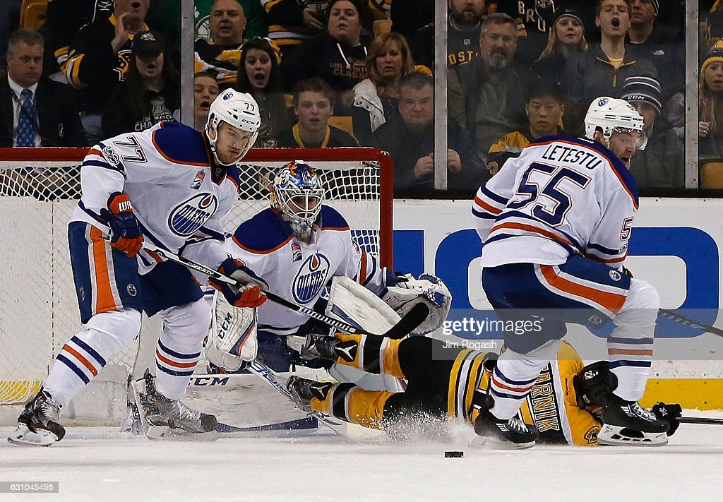 Oscar Klefbom #77 of the Edmonton Oilers and Cam Talbot #33 defends the net from Austin Czarnik #27 of the Boston Bruins in the second period at TD Garden on January 5, 2017 in Boston, Massachusetts. The Oilers won 4-3.