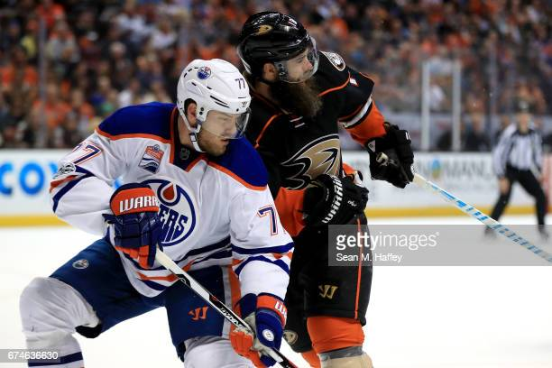 Oscar Klefbom of the Edmonton Oilers and Patrick Eaves of the Anaheim Ducks collide during the first period of Game Two of the Western Conference...