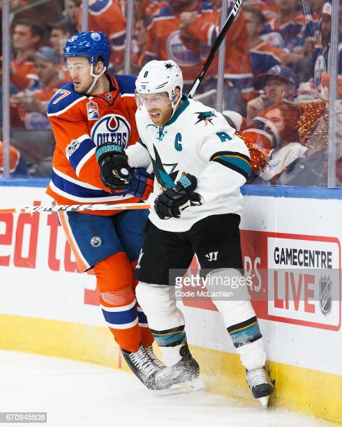 Oscar Klefbom of the Edmonton Oilers battles against Joe Pavelski of the San Jose Sharks in Game Five of the Western Conference First Round during...