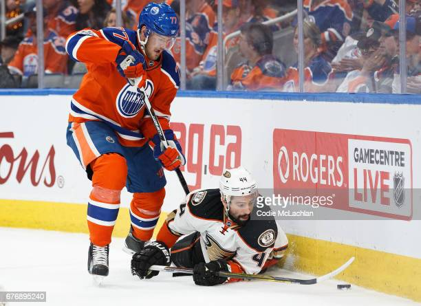 Oscar Klefbom of the Edmonton Oilers battles against Nate Thompson of the Anaheim Ducks in Game Three of the Western Conference Second Round during...