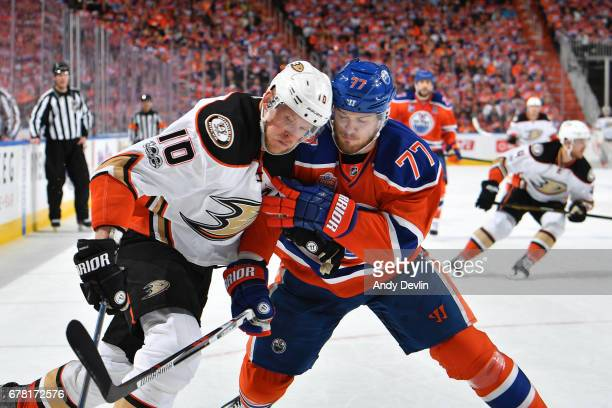 Oscar Klefbom of the Edmonton Oilers battles for the puck against Corey Perry of the Anaheim Ducks in Game Four of the Western Conference Second...