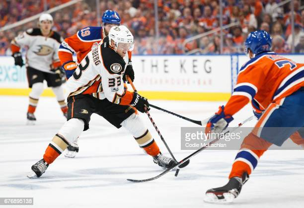 Oscar Klefbom of the Edmonton Oilers defends against Jakob Silfverberg of the Anaheim Ducks in Game Three of the Western Conference Second Round...