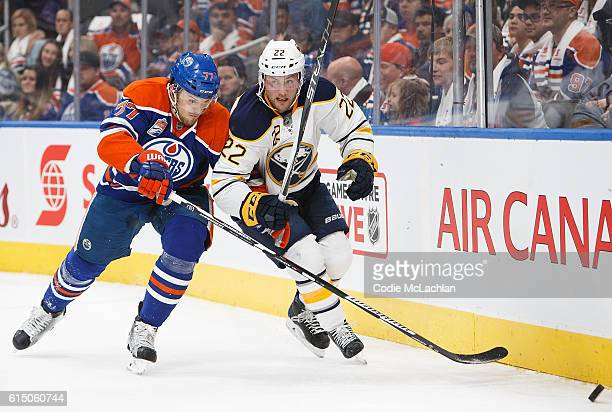 Oscar Klefbom of the Edmonton Oilers defends against Johan Larsson of the Buffalo Sabres on October 16 2016 at Rogers Place in Edmonton Alberta Canada