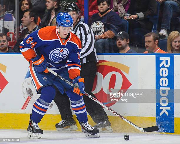 Oscar Klefbom of the Edmonton Oilers in action against the Buffalo Sabres during an NHL game at Rexall Place on March 20 2014 in Edmonton Alberta...