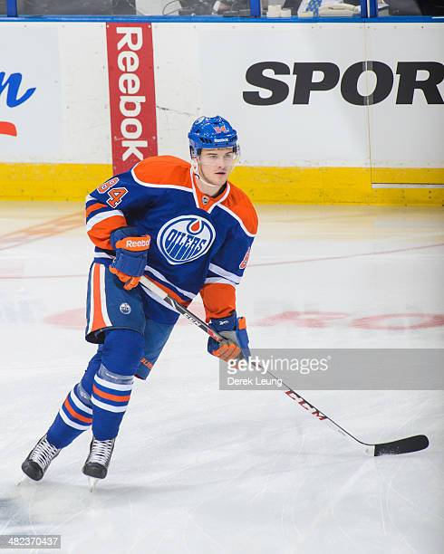 Oscar Klefbom of the Edmonton Oilers in action against the San Jose Sharks during an NHL game at Rexall Place on March 25 2014 in Edmonton Alberta...