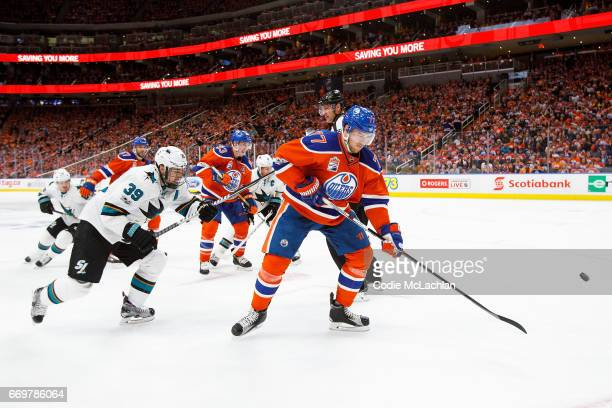 Oscar Klefbom of the Edmonton Oilers is pursued by Logan Couture of the San Jose Sharks in Game Two of the Western Conference First Round during the...