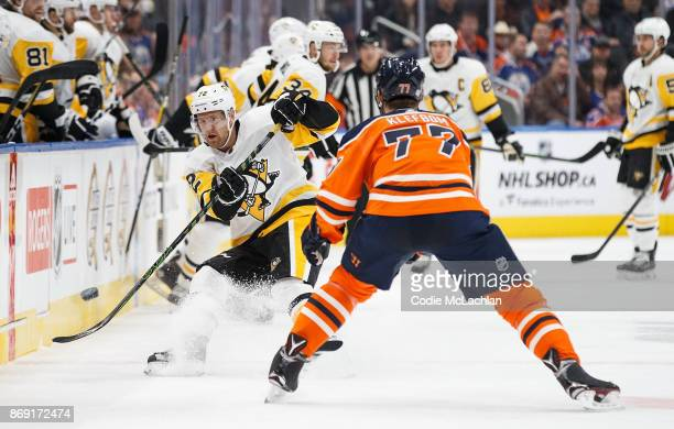 Oscar Klefbom of the Edmonton Oilers keeps an eye on Patric Hornqvist of the Pittsburgh Penguins at Rogers Place on November 1 2017 in Edmonton Canada