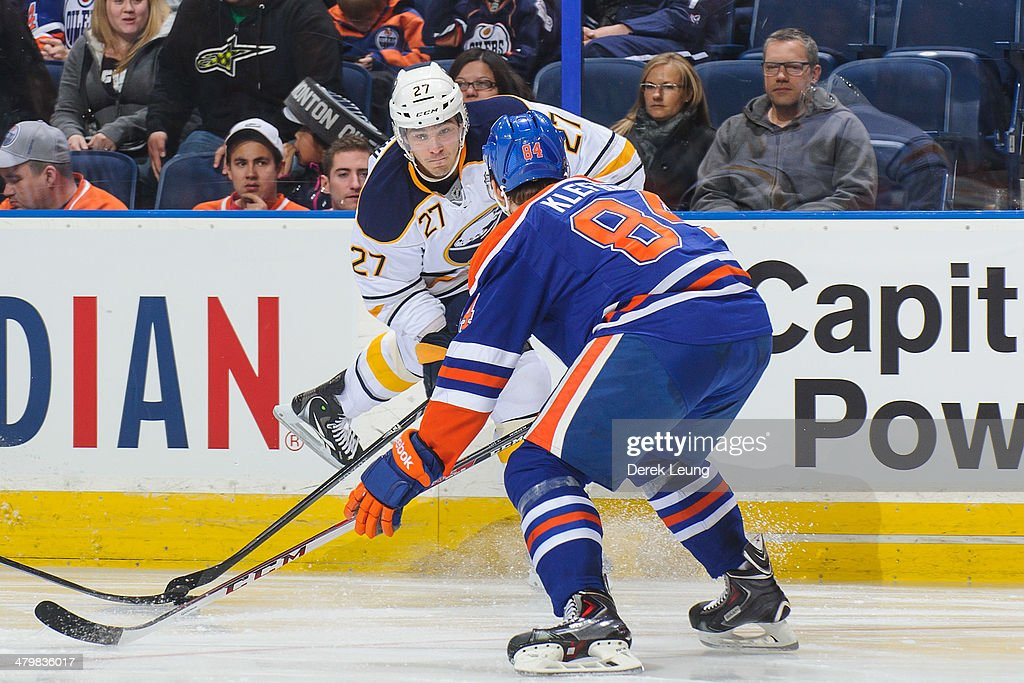 Oscar Klefbom #84 of the Edmonton Oilers looks to block the pass of Matt D'Agostini #27 of the Buffalo Sabres during an NHL game at Rexall Place on March 20, 2014 in Edmonton, Alberta, Canada. The Sabres defeated the Oilers 3-1.