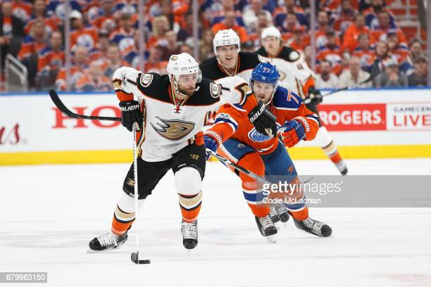Oscar Klefbom of the Edmonton Oilers pursues Andrew Cogliano of the Anaheim Ducks in Game Four of the Western Conference Second Round during the 2017...