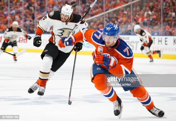 Oscar Klefbom of the Edmonton Oilers races against Ryan Getzlaf of the Anaheim Ducks in Game Three of the Western Conference Second Round during the...