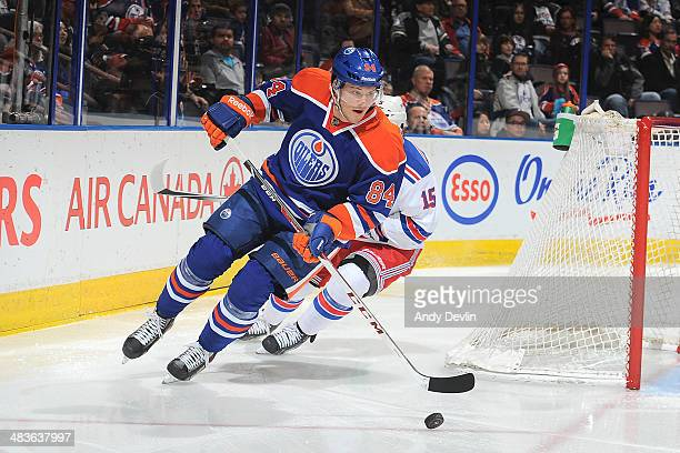 Oscar Klefbom of the Edmonton Oilers skates on the ice in a game against the New York Rangers on March 30 2014 at Rexall Place in Edmonton Alberta...