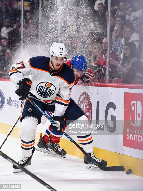 Oscar Klefbom of the Edmonton Oilers skates the puck against Alex Galchenyuk of the Montreal Canadiens during the NHL game at the Bell Centre on...