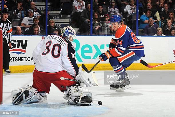 Oscar Klefbom of the Edmonton Oilers takes a shot that is turned aside by Curtis McElhinney of the Columbus Blue Jackets on March 18 2015 at Rexall...