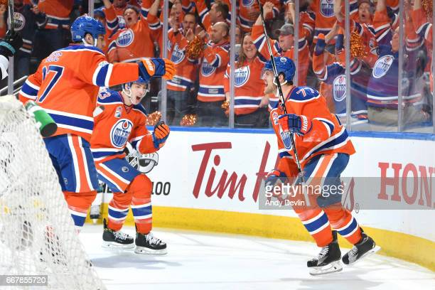 Oscar Klefbom Ryan NugentHopkins and Milan Lucic of the Edmonton Oilers celebrate after a goal during Game One of the Western Conference First Round...