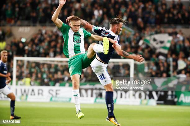 Oscar Krusnell of Hammarby IF and Linus Wahlqvist of IFK Norrkoping during the Allsvenskan match between Hammarby IF and IFK Norrkoping at Tele2...