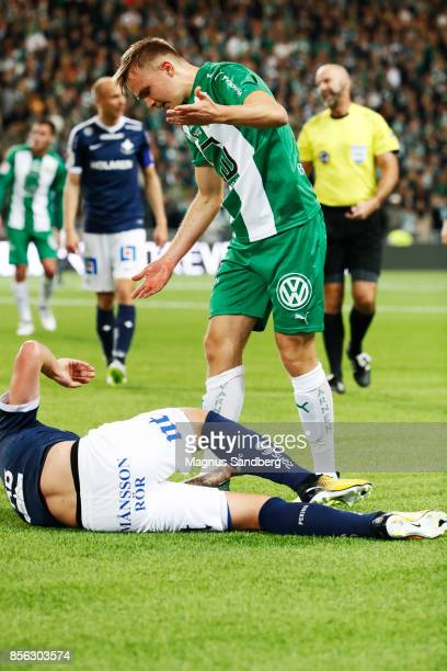 Oscar Krusnell of Hammarby IF tackles player of IFK Norrkoping during the Allsvenskan match between Hammarby IF and IFK Norrkoping at Tele2 Arena on...