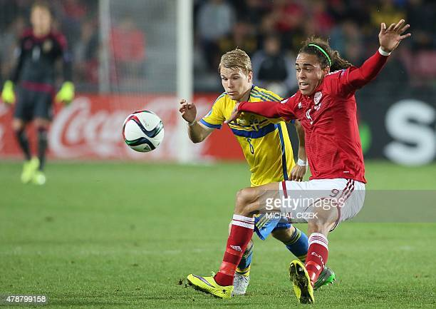 Oscar Lewicki of Sweden vies for a ball with Denmark's Yussuf Poulsen during the UEFA Under 21 European Championship 2015 semi final football match...