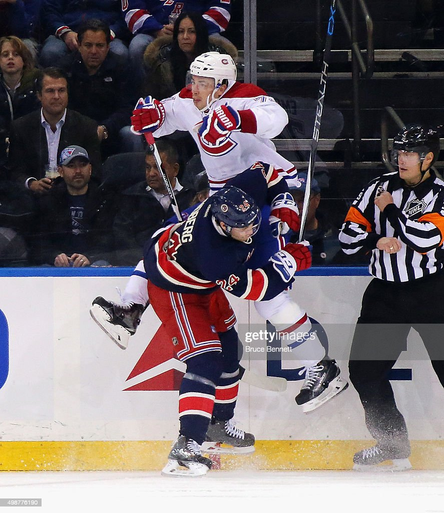 <a gi-track='captionPersonalityLinkClicked' href=/galleries/search?phrase=Oscar+Lindberg&family=editorial&specificpeople=7029380 ng-click='$event.stopPropagation()'>Oscar Lindberg</a> #24 of the New York Rangers checks <a gi-track='captionPersonalityLinkClicked' href=/galleries/search?phrase=Alexei+Emelin&family=editorial&specificpeople=723573 ng-click='$event.stopPropagation()'>Alexei Emelin</a> #74 of the Montreal Canadiens into the boards during the third period at Madison Square Garden on November 25, 2015 in New York City. The Canadiens defeated the Rangers 5-1.