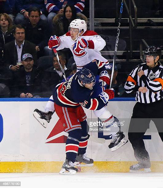 Oscar Lindberg of the New York Rangers checks Alexei Emelin of the Montreal Canadiens into the boards during the third period at Madison Square...