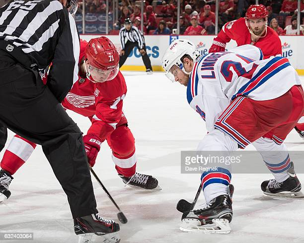 Oscar Lindberg of the New York Rangers faces off against Dylan Larkin of the Detroit Red Wings during an NHL game at Joe Louis Arena on January 22...