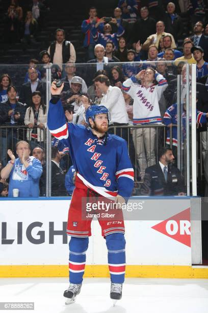 Oscar Lindberg of the New York Rangers salutes the crowd after being named the first star of the game against the Ottawa Senators in Game Four of the...
