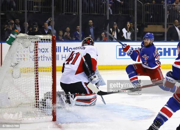 Oscar Lindberg of the New York Rangers scores at 201 of the second period against Craig Anderson of the Ottawa Senators in Game Four of the Eastern...