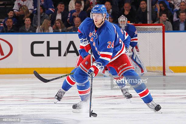 Oscar Lindberg of the New York Rangers skates with the puck against the Columbus Blue Jackets at Madison Square Garden on October 10 2015 in New York...