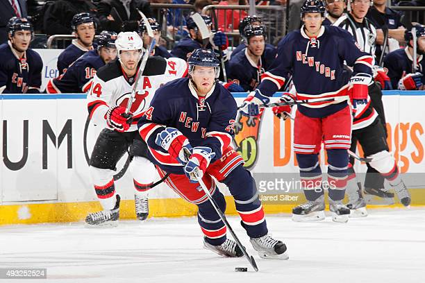 Oscar Lindberg of the New York Rangers skates with the puck against the New Jersey Devils at Madison Square Garden on October 18 2015 in New York City