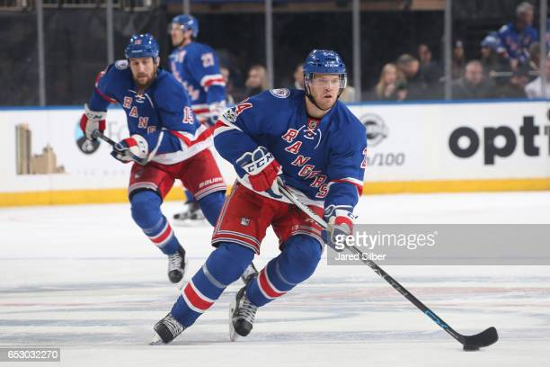 Oscar Lindberg of the New York Rangers skates with the puck against the Tampa Bay Lightning at Madison Square Garden on March 13 2017 in New York City
