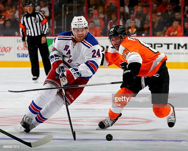 Oscar Lindberg of the New York Rangers tries to keep the puck from Sam Gagner of the Philadelphia Flyers on April 7 2015 at the Wells Fargo Center in...