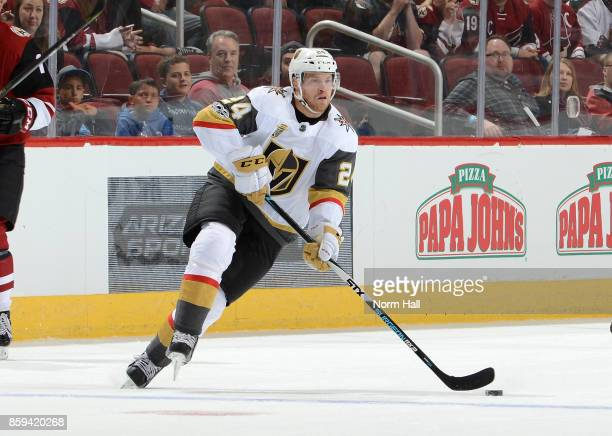 Oscar Lindberg of the Vegas Golden Knights skates with the puck against the Arizona Coyotes at Gila River Arena on October 7 2017 in Glendale Arizona