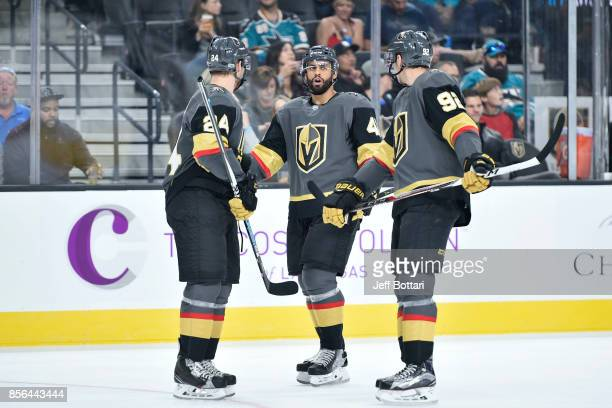 Oscar Lindberg PierreEdouard Bellemare and Tomas Nosek of the Vegas Golden Knights talk during a break in the game against the San Jose Sharks at...