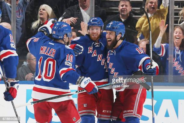 Oscar Lindberg Tanner Glass and JT Miller of the New York Rangers celebrate after scoring a goal in the second period against the Ottawa Senators in...