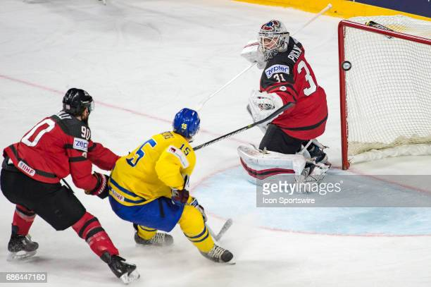 Oscar Lindberg tries to score against Goalie Calvin Pickard and Ryan OReilly during the Ice Hockey World Championship Gold medal game between Canada...