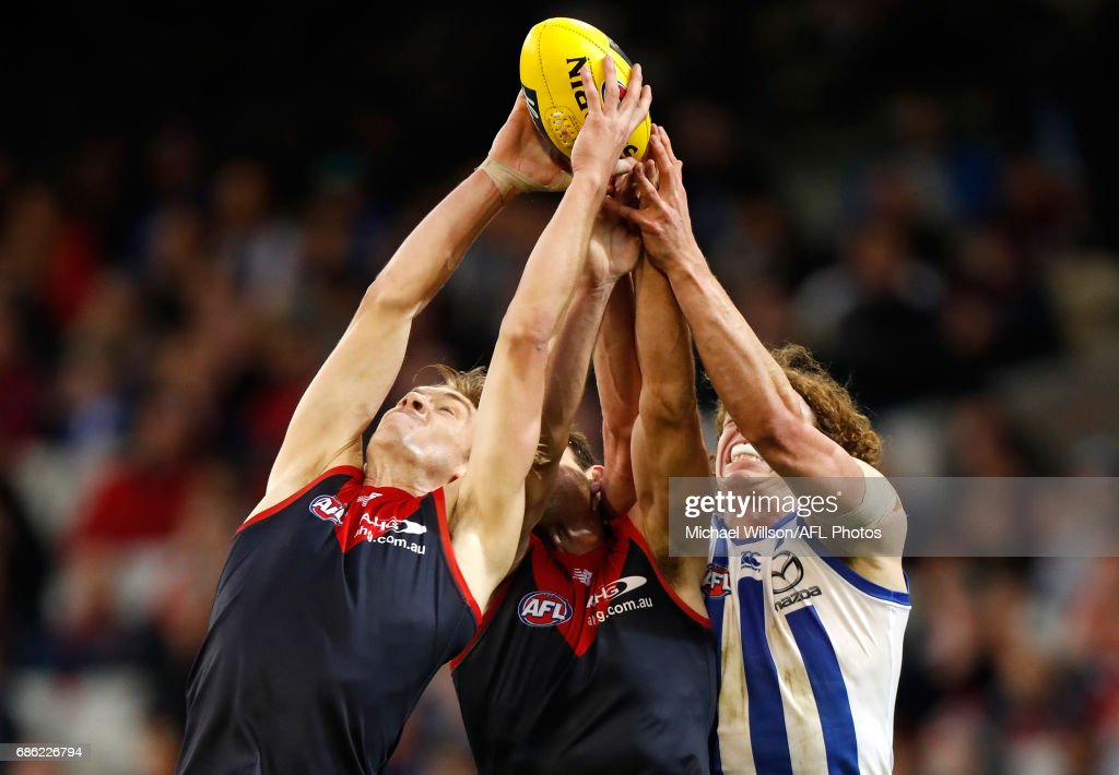 Oscar McDonald and Cameron Pedersen of the Demons compete for the ball against Ben Brown of the Kangaroos during the 2017 AFL round 09 match between the Melbourne Demons and the North Melbourne Kangaroos at the Melbourne Cricket Ground on May 21, 2017 in Melbourne, Australia.