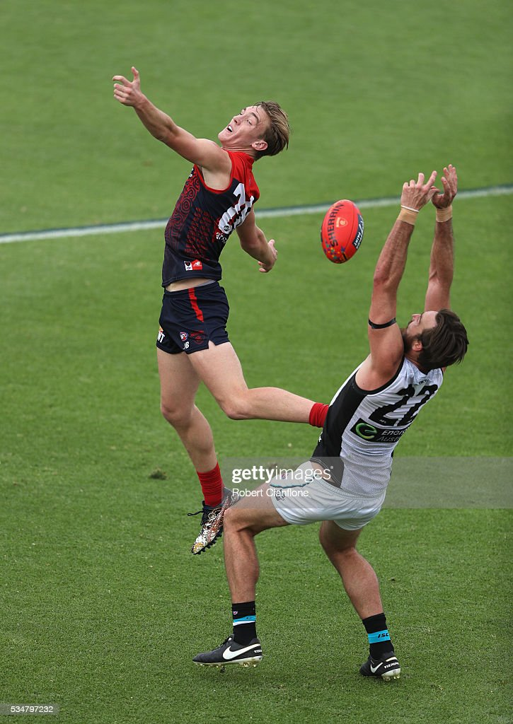 Oscar McDonald of the Demons and Charlie Dixon of Port Adelaide compete for the ball during the round 10 AFL match between the Melbourne Demons and the Port Adelaide Power at Traeger Park on May 28, 2016 in Alice Springs, Australia.