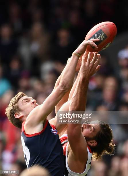 Oscar McDonald of the Demons and Josh Bruce of the Saints compete for a mark during the round 21 AFL match between the Melbourne Demons and the St...