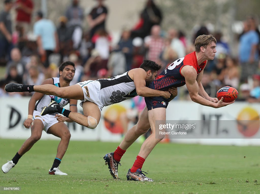 Oscar McDonald of the Demons is challenged by Jarman Impey of Port Adelaide during the round 10 AFL match between the Melbourne Demons and the Port Adelaide Power at Traeger Park on May 28, 2016 in Alice Springs, Australia.