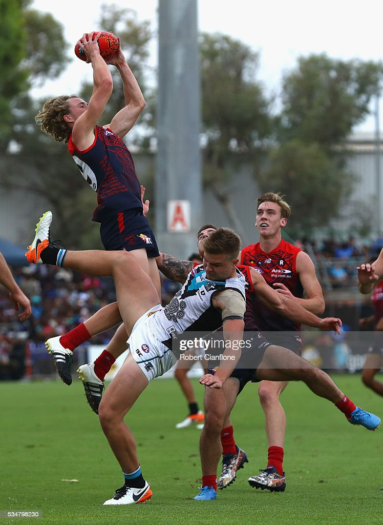 Oscar McDonald of the Demons marks the ball during the round 10 AFL match between the Melbourne Demons and the Port Adelaide Power at Traeger Park on May 28, 2016 in Alice Springs, Australia.