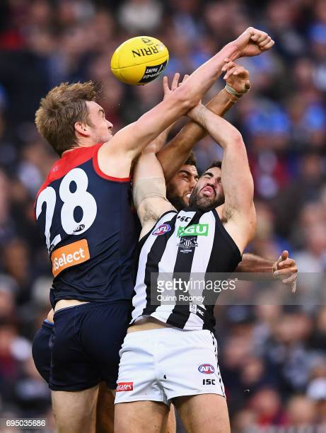 Oscar McDonald of the Demons spoils a mark by Alex Fasolo of the Magpies during the round 12 AFL match between the Melbourne Demons and the...