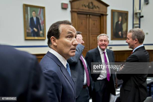 Oscar Munoz chief executive officer of United Continental Holdings Inc stands in the House Transportation and Infrastructure Committee hearing room...