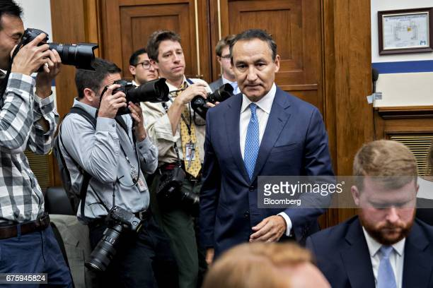Oscar Munoz chief executive officer of United Continental Holdings Inc walks past photographers before the start of a House Transportation and...