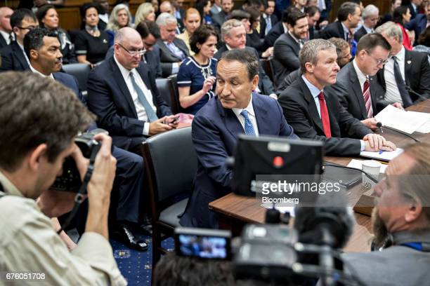 Oscar Munoz chief executive officer of United Continental Holdings Inc center waits to begin a House Transportation and Infrastructure Committee...
