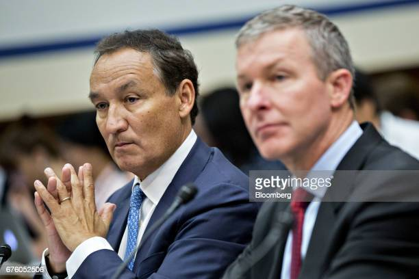 Oscar Munoz chief executive officer of United Continental Holdings Inc left and Scott Kirby president of United Continental Holdings listen during a...