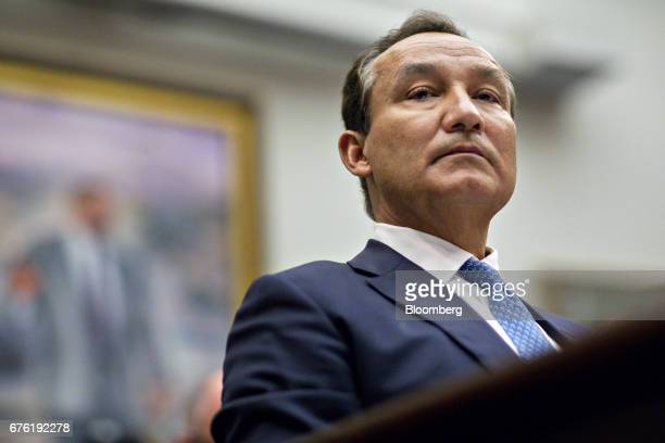 Oscar Munoz chief executive officer of United Continental Holdings Inc listens during a House Transportation and Infrastructure Committee hearing in...