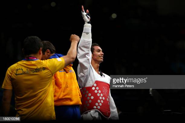 Oscar Munoz Oviedo of Colombia celebrates victory in the Men's 58kg Taekwondo bronze medal match against PenEk Karaket of Thailand on Day 12 of the...