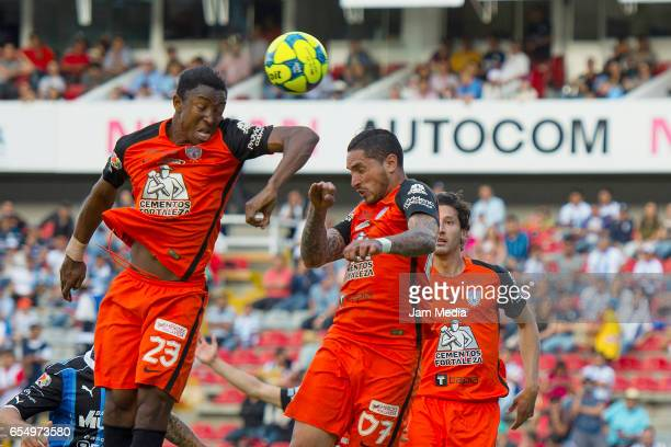 Oscar Murillo and Braian Rodríguez of Pachuca jump for a header during the 11th round match between Queretaro and Pachuca as part of the Torneo...