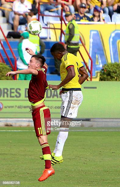 Oscar Murillo of Colombia struggles for the ball with Juan Pablo Añor of Venezuela during a match between Colombia and Venezuela as part of FIFA 2018...
