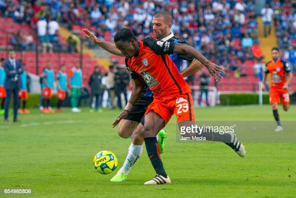Oscar Murillo of Pachuca and Emanuel Villa of Queretaro fight for the ball during the 11th round match between Queretaro and Pachuca as part of the...